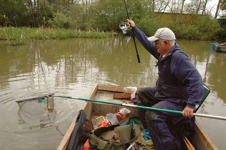 Fishing-from-a-boat-on-The-Old-Lake-t-Bury-Hill
